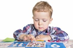 Boy counting with a book Royalty Free Stock Image