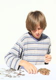 Boy counting money. Concentrated boy counting money - savings of czech crowns - small change Royalty Free Stock Photo