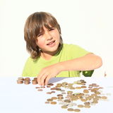 Boy counting money. Smiling boy counting money - savings of czech crowns - small change Stock Image