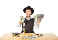 Boy counting money on the table. Boy in black hat counting money on the table, isolated on white Royalty Free Stock Photos