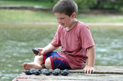 Boy Counting shells royalty free stock photo