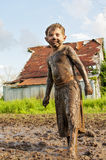 Boy covered in mud Stock Images