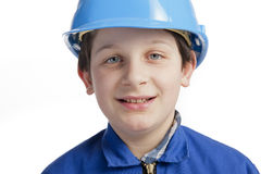 Boy with coverall and protection helmet Royalty Free Stock Photo