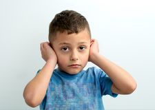The boy covered his ears with his hands royalty free stock photography