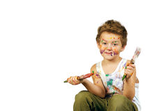Boy covered in paint , isolated on white background. Baby boy having fun playing , stained with paint royalty free stock photo