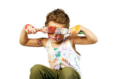 Boy covered in paint , isolated on white background. Baby boy having fun playing , stained with paint stock photos