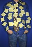 Boy covered with sticky notes. Royalty Free Stock Photography