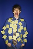 Boy covered with sticky notes. Royalty Free Stock Photos
