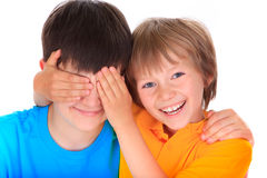 Boy covering brothers eyes Royalty Free Stock Images