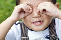 Boy covering eyes Stock Image