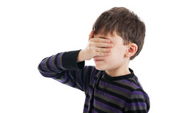 Boy covering eyes Stock Photo