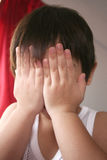 Boy covering face. Boy's both hands covering face Royalty Free Stock Photo