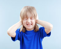 Boy covering his ears Stock Photography