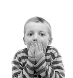 Boy covering his mouth Royalty Free Stock Images