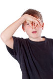 Boy covers his nose Royalty Free Stock Image