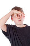 Boy covers his nose Royalty Free Stock Photos