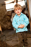 Boy in a cow stable Stock Photo