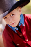 Boy in cowboy hat. Portrait of young boy in red shirt and cowboy hat outdoors Royalty Free Stock Photos