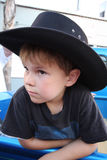 Boy in cowboy hat Stock Images