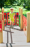 Boy in cowboy hat on the playground. Three year old boy in cowboy hat running on the playground. Summertime. The child is wearing orthopedic shoes Royalty Free Stock Photo