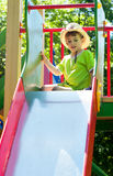 Boy in cowboy hat on the playground Stock Photo