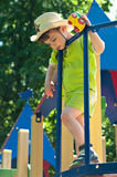 Boy in cowboy hat on the playground. Three year old boy in cowboy hat stands on the playground. In his hands he holds a toy car. Summertime Royalty Free Stock Image