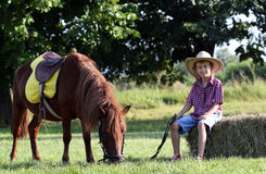 Boy with cowboy hat and pony horse Royalty Free Stock Photos