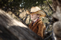 Boy in cowboy outfit. A boy in cowboy outfit outdoors with a rifle Royalty Free Stock Photography