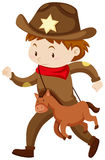 Boy in cowboy outfit with toy horse Royalty Free Stock Images