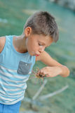 Boy with crab Royalty Free Stock Photos