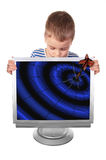 Boy with cracked monitor into which fell dart Royalty Free Stock Photo