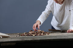 Boy cracking nuts Stock Photos