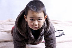 Boy creeping. A picture of a chinese little boy creeping on the floor Stock Photo