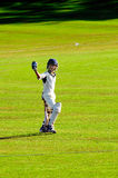 Boy cricketer. Portrait of boy going to bat in game of cricket Stock Image