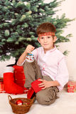 The boy with cristmas presents Stock Photos