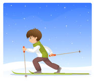Boy cross country skiing Stock Images