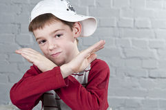 Boy with crossed arms in the form X Royalty Free Stock Photos