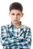 Boy with crossed hands Royalty Free Stock Photography