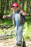 Boy crossing path by log Stock Images