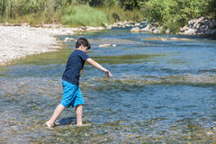Boy crossing a river Royalty Free Stock Image