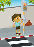 Boy crossing road Stock Photo