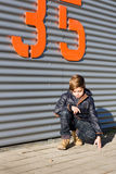 Boy crouching Royalty Free Stock Photography