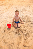 Boy crying on the beach Royalty Free Stock Photography