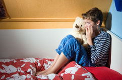 Boy crying on his bed Royalty Free Stock Photography