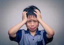 Boy crying over dark background Stock Image