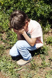 Boy crying in the park stock photos