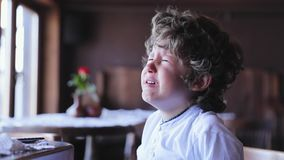 Boy crying. Upset little child cry at cafe. Kid crying indoors stock video footage