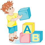 Boy with cubes. Vector little boy plays with cubes Royalty Free Stock Photography