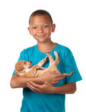 Boy cuddles puppy Stock Images