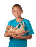 Boy cuddles puppy Stock Images